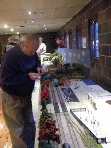 Stoney Creel Model Railroad Club prepares train exhibit at Rochester Hills Museum.