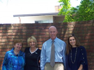 From L-R: Maria Trahan, President of Women's Fund; Dianne Bette, Neighborhood House Caseworker; Mark Kilbourn, Neighborhood House Executive Director; Johanna Byrd, Past President of Women's Fund  Photo courtesy of the Neighborhood House