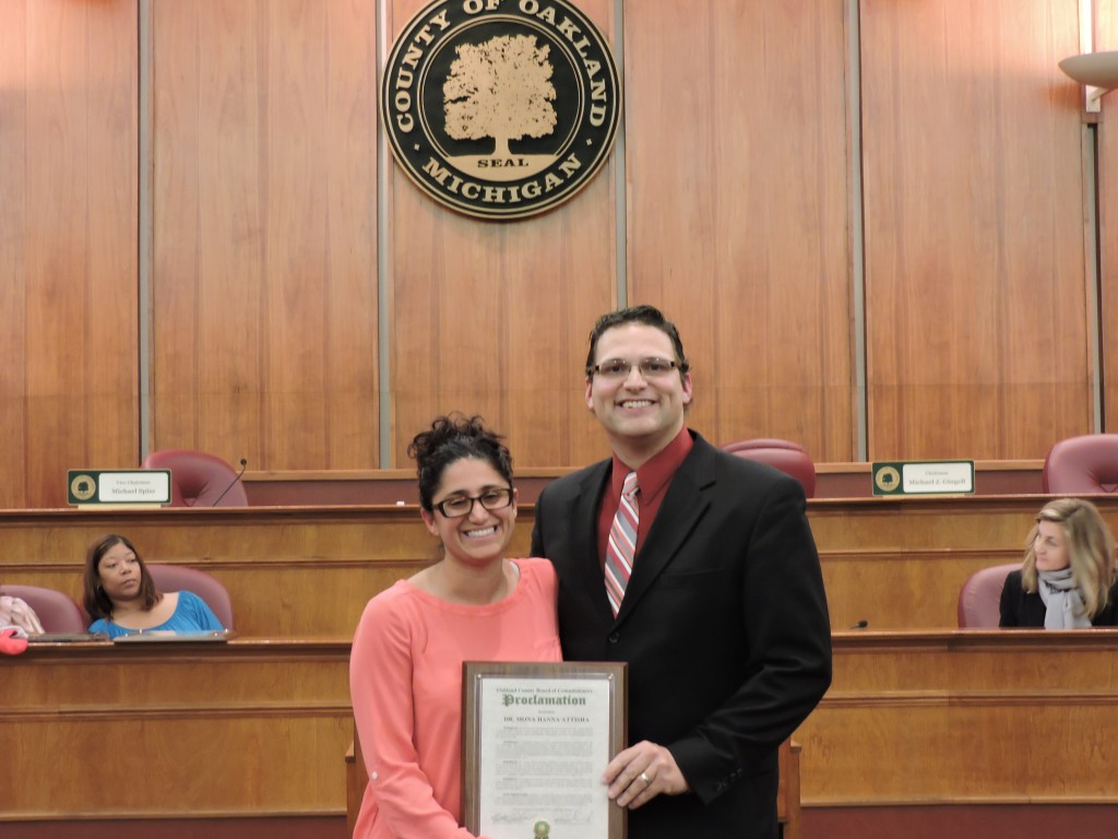 Pictured left to right: Oakland County resident Dr. Mona Hanna Attisha holding her proclamation and Oakland County Board of Commissioner David Woodward at the December 9, 2015 Board meeting held in the Oakland County Board of Commissioners' Auditorium, located at 1200 North Telegraph Road, in Pontiac, Michigan.  Photo credit: Julia Ruffin, BOC