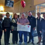 Dale Bigger holds his check for $7,000 at Oakland Christian School in Auburn Hills