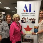 Assistance League members Betty Zych, VP Fund Development (L), and Rosemary Dirksen, President, gratefully accept a check for $8,100 from Leanne Scott, Rochester Hills Deputy Clerk (R), on behalf of the Rochester Hills Government Youth Council
