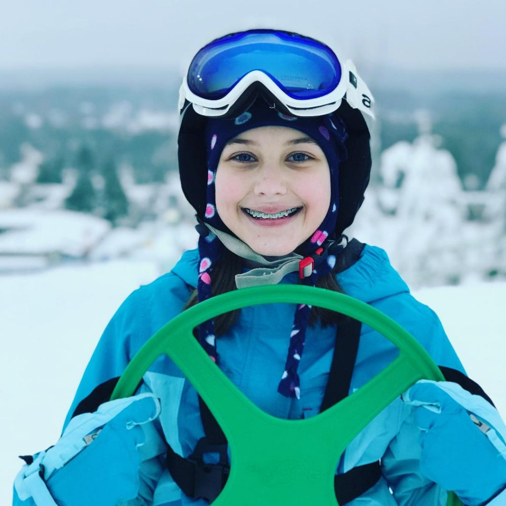 Young skier smiling and holding the SkiRing