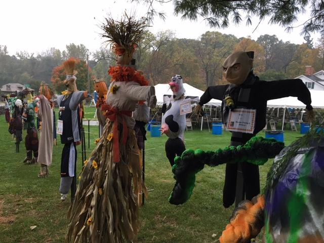 Previous scarecrows decorated and placed outside of the museum