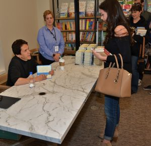 Albom signs books for people waiting in line