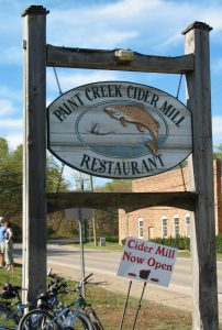 The Former Paint Creek Cider Mill Restaurant Sign, oval shape, with a fish as it's focal point